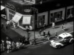 1947 MONTAGE downtown Brooklyn streets with traffic and pedestrians / New York, New York, United States