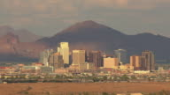 MS AERIAL Downtown buildings with mountains / Phoenix, Arizona, United States