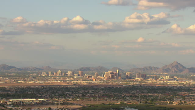 WS AERIAL Downtown buildings with mountains / Phoenix, Arizona, United States