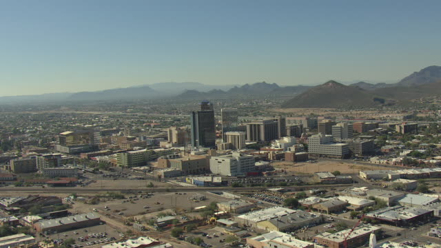 WS AERIAL Downtown buildings with mountains / Tucson, Arizona, United States