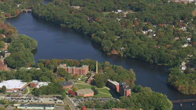 AERIAL Downtown commercial buildings amid trees and beside Connecticut River / Springfield, Massachusetts, United States