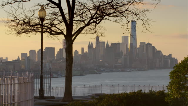 Downtown Manhattan early morning, a park is in the foreground