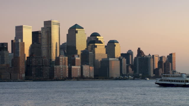 WS Downtown skyline across Hudson river at sunset / New York City, New York, USA