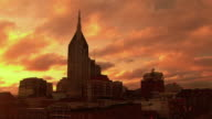 T/L, WS, Downtown skyline against dramatic sky at sunset, Nashville, Tennessee, USA