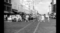 Downtown street scene Central Avenue with car traffic and pedestrians crossing the street / McRory's the Rutland Building in view Downtown street...