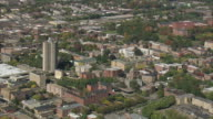 AERIAL Downtown with commercial buildings, historic industrial area, and trees / Springfield, Massachusetts, United States