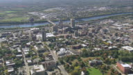 AERIAL Downtown with Connecticut River and Memorial Bridge / Springfield, Massachusetts, United States
