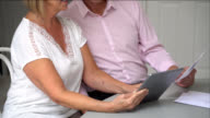 Downwards tilt view of couple paying bills online