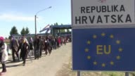 A dozen busses drove several hundreds of migrants to the checkpoint of Beremend on the Hungary/Croatia border so they could be transferred to Austria...