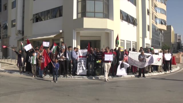 Dozens of activists stage a protest outside the British embassy in the capital Tunis to demand the UK's apology for the Balfour Declaration on...