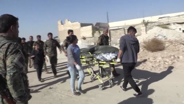 Dozens of civilians at a checkpoint into Raqa were pleading to be let through to inspect their homes when an explosion ripped through the air one...