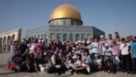 Dozens of Palestinian children from the Gaza Strip saw Jerusalem and two of its holy sites for the first time on Sunday as part of a UN run exchange...