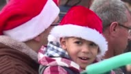 Dozens of Palestinians and tourists flocked to Bethlehem's Manger Square near the Church of the Nativity where celebrations will culminate with a...