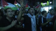 Dozens of Palestinians gathered Wednesday night in Ramallah to protest against the Israeli offensive on Gaza which killed at least 30 people in a...