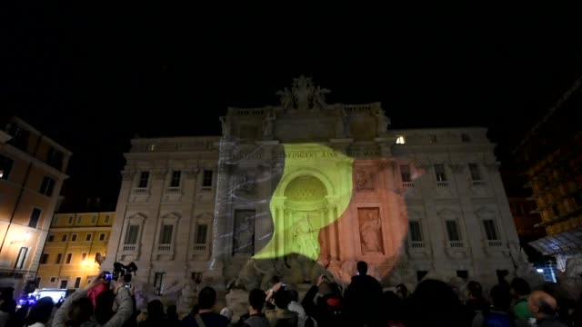 Dozens of people gathered on Tuesday night by the Fontana di Trevi in Rome wearing the colours of the Belgian flag as a sign of solidarity after the...