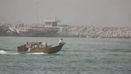 Dozens of unmarked speedboats pulled into Oman's Khasab port breaking the dawn silence and marking the start of a wet and treacherous workday for...