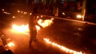 Dozens of young people separated into two camps participate at the Fireballs Festival of Nejapa some 20 km north of San Salvador