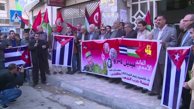 Dozens on members of the Palestinian People's Party gathered on Sunday in Gaza City to mourn the the death of Fidel Castro carrying Cuban flags and...