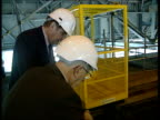 Dr Derrik Littler interview SOT TGV Core of reactor LA BV TMS John Buffery and Dr Littler up stairs at plant BV Buffery and Littler looking down on...