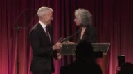 Dr Jane Aronson presents Anderson Cooper with 2010 Honorary Orphan Ranger award at the Worldwide Orphans Foundation Sixth Annual Benefit Gala Hosted...