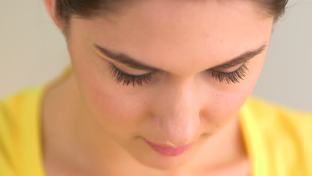 Dramatic close up of woman looking down