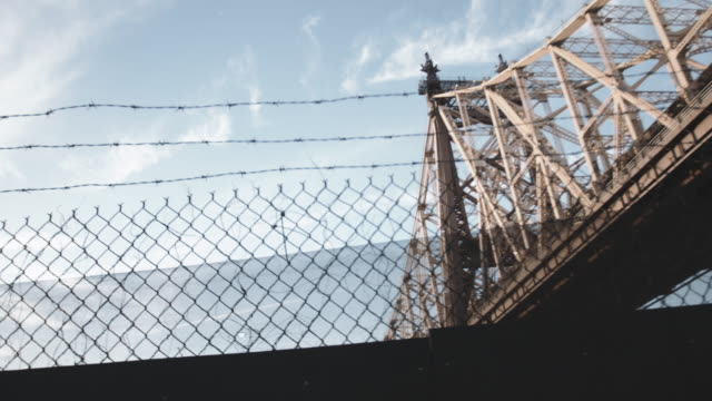 dramatic dolly shot of NYC's Queensboro Bridge during the summer of 2017