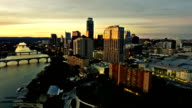 Dramatic High Contrast Sunset Aerial Drone View Austin Texas Skyline Cityscape Fly Over Downtown Capital City