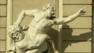 Dramatic marble statues decorate Hofburg Palace in Vienna. Available in HD.