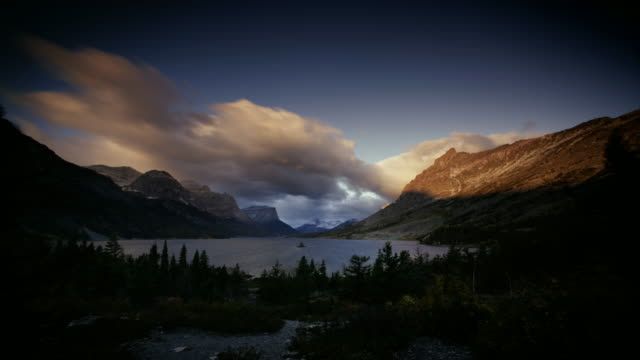 T/L WS Dramatic sky above St. Mary Lake and mountains at sunset, Glacier National Park, Montana, USA