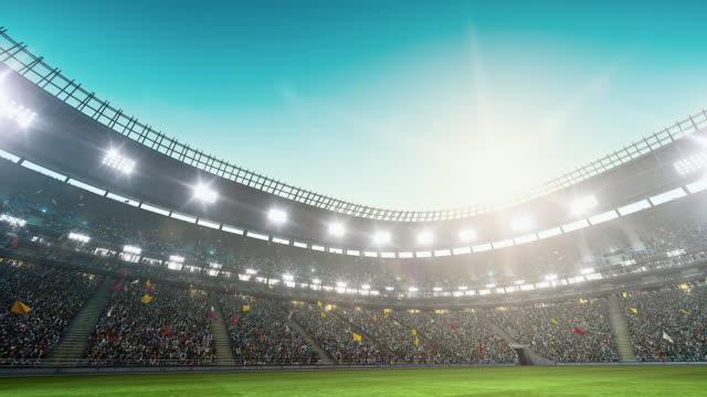 Dramatiska fotbollsstadion full av åskådare