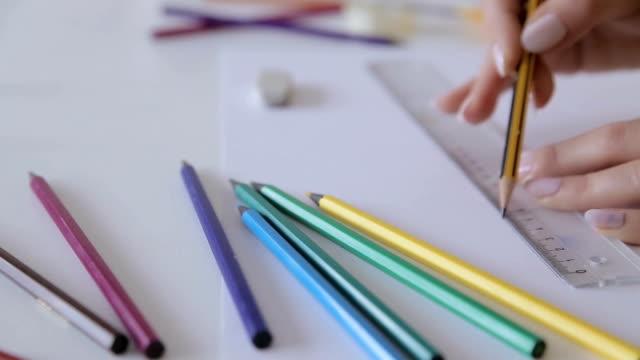 drawing ruler,human hand close up