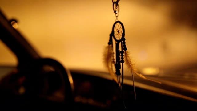 Dream catcher decoration in vintage car