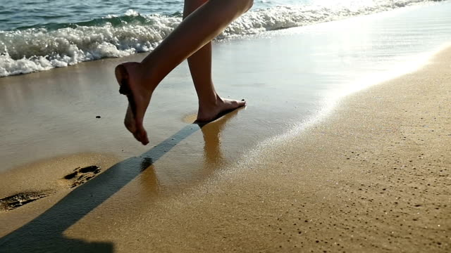 Dreamlike walk with footprint on beach