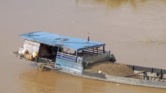 Dredging barge loaded with sand on the river