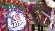 Dressed as Dionysus Aphrodite and Apollo Rio de Janeiro residents danced in the streets Saturday taking on an Olympic theme a nod to the summer games...