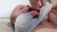 CU Dressing a baby