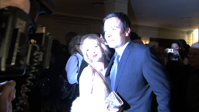 HD Drew Barrymore Jimmy Fallon posing together in crowded Pierre Hotel lobby for press photographs BRIGHT FLASHES photographer FG