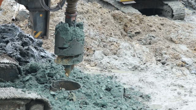 Drilling rigs for footing building structures