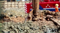 Drilling soil machine on Construction site,Tilt down shot