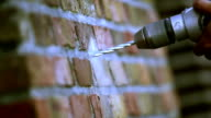 Drilling through a brick wall