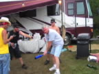 Drinking games are glorious until they go sour Watch this guy do the running around a bat trick to get dizzy and see him crash into the party grill
