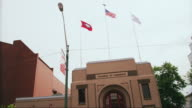 Drive by Fort Smith Chamber of Commerce building with flags flying