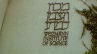 Drive by in Rehovot / Shot of Library Exterior / Weizmann Institute Signage / Weizmann Institute of Science on September 01 1974 in Rehovot Israel