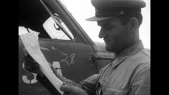 MS driver in cab of US military truck presents papers to Soviet officer / CU officer reads papers returns them to driver TILT DOWN to writing on door...