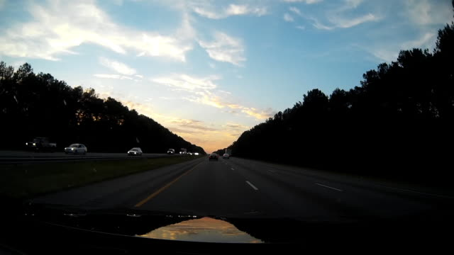 Driver pov of driving at Sunset in USA