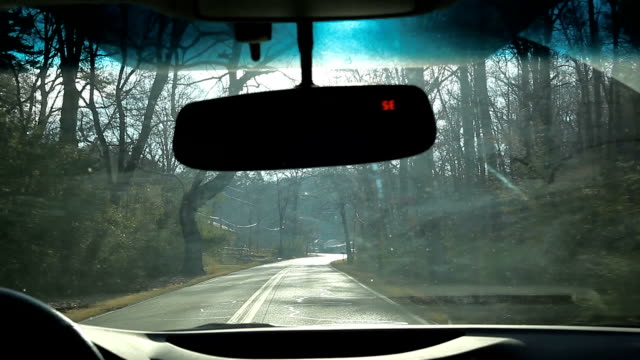 Driver pov of driving on a small country road under the sunlight in USA in Winter