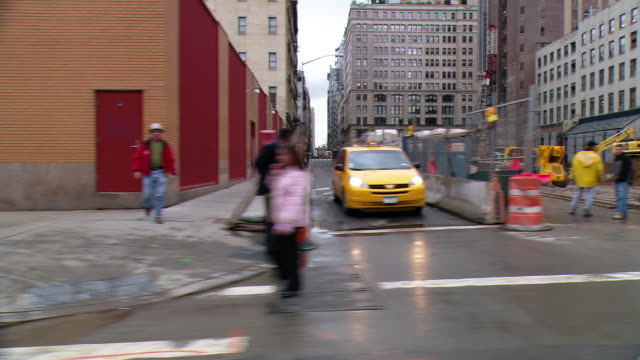 POV Driver side view from car driving down street in a business area of Tribeca / New York City, New York, United States