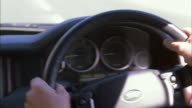 POV Driver steering a right-hand drive car at speed