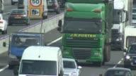 Driverless lorries to be trialled on UK motorways EXT Lorries on busy motorway/ Vox pops