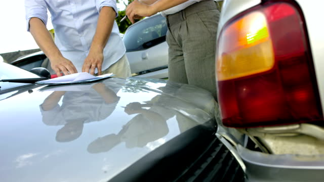 MS TU Drivers Filling Out An Accident Report